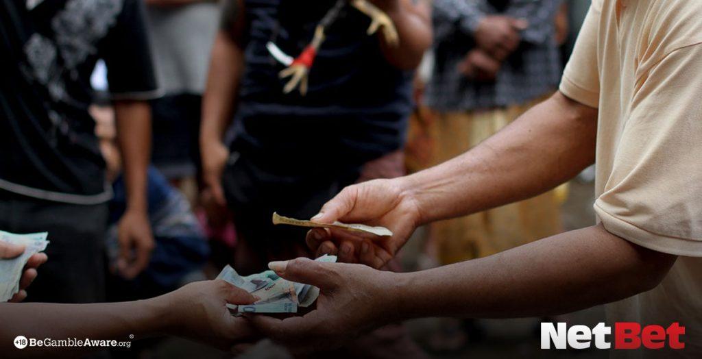 Men handling money in a casino